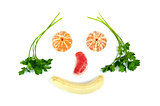 Face made of fruits  and parsley