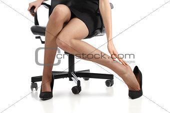 Business woman touching feet with her hand