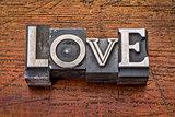 love word in metal type
