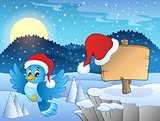 Christmas theme with bird and sign
