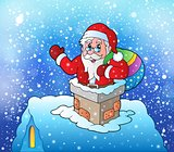 Santa Claus on snowy roof