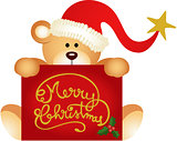 Christmas teddy bear holding a Merry Christmas