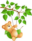 Teddy bear swinging from a tree
