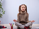 little girl meditating instead of making homework