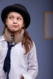 little girl thinking perplexed in a strange costume