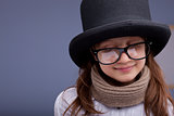 funny little girl with big glasses and a big top-hat