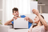 wife showing a tablet to his husband