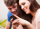 young woman and man with a mobile phone