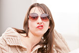 woman with sunglasses making funny faces
