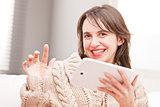 woman succesfully using her tablet and smiling
