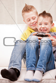 little brothers playing videogames together