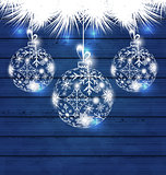 Christmas balls made in snowflakes on blue wooden background