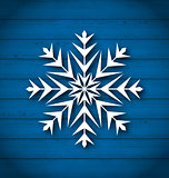 Geometric snowflake on wooden background