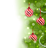 Christmas glowing background with fir branches and glass balls