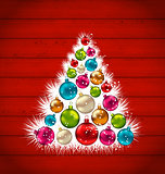 Abstract Christmas tree and colorful balls on wooden background