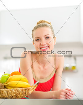 Portrait of young woman with fruits