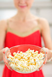 Closeup on young woman giving popcorn