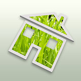 Conceptual green grass house