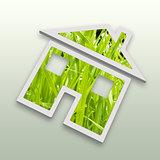 Conceptual green grass house