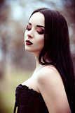 Closeup portrait of beautiful young goth girl