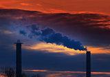 Heavy smoke spewed from coal powered plant smoke stacks
