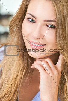 Smiling Beautiful Woman Resting on Hand