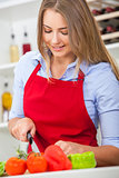 Woman Preparing Vegetables Salad Food in Kitchen