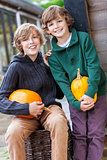 Two Happy Boys Brother With Pumpkins
