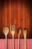 Wooden Kitchen Utensils on Wooden Background