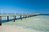Wooden jetty on tropical beach