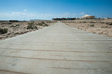 Wooden walkway across sand dune