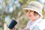 Woman  with cup of coffee  in nature