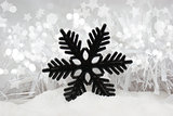 Snowflake decoration in snow