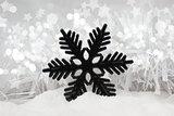 Snowflake decoration in snow