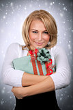 Cute woman holding gift box
