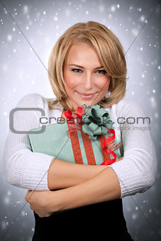 Cute woman holding gift box