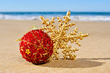 christmas ball and star on the beach