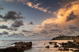 Sunrise over rocky coastline on Mediterranean Sea