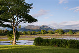View from Porthmadog Cob towards Snowdonia mountains landscape d