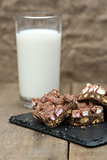 Rustic background with rocky road dessert squares with glass of