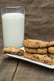 Rustic setting with chocolate chip cookies and glass of milk