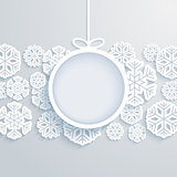 Christmas paper card with hanging toy and snowflakes.
