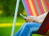 Young Woman Using Mobile Smart Phone Outdoors