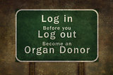 """Log in before you log out become an organ donor"" roadside sign"