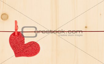 one decorative red heart hanging on wood background, concept of valentine day