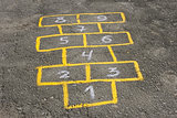 Childish game hopscotch on asphalt