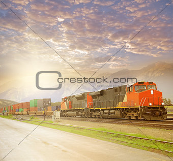 Freight train in Canadian rockies at sunset.