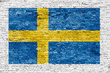 Swedish flag painted over white wall