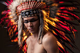 Indian strong man with traditional native american make up