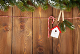 Snow fir tree and christmas decor on rope